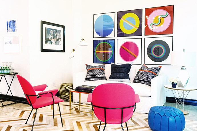 """Definitely not a space for shrinking violets. A chevron rug, fuchsia chairs and cobalt pouf balance the graphic wall art. <br><br> <em>Image courtesy of <a href=""""http://www.domainehome.com/whitney-port-office-one-kings-lane/"""">domaynehome.com</a></em>"""