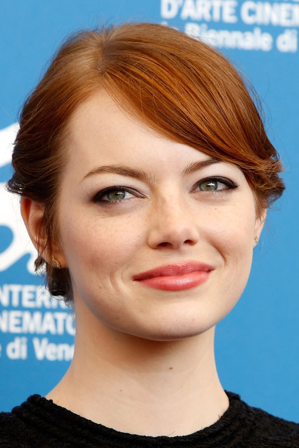 At the Cannes Film Festival Emma wore a soft side fringe and rosy lipstick.