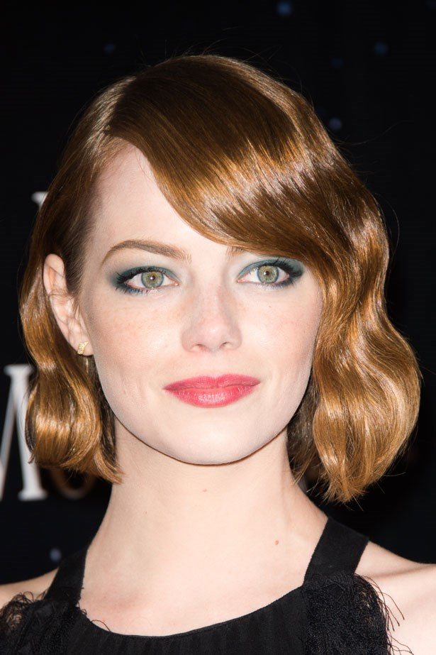 Premiering her new movie <em>Magic in the Moonlight</em>, a teal smoky eye highlighted her hair's auburn tones.