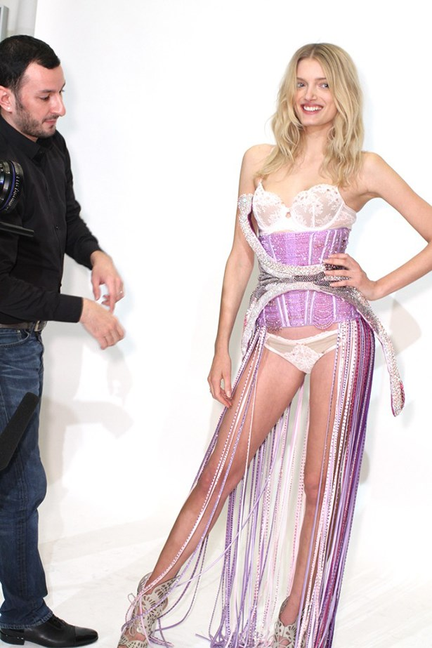 Donaldson gets fitted into her bejeweled costume by Parisian designer Serkan Cura ahead of the London runway show.