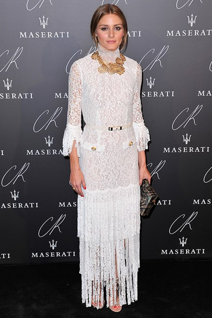 Olivia Palermo goes all white lace at the CR Fashion Book: Issue 5 Launch Party and adds the perfect box clutch to toughen this demure look.