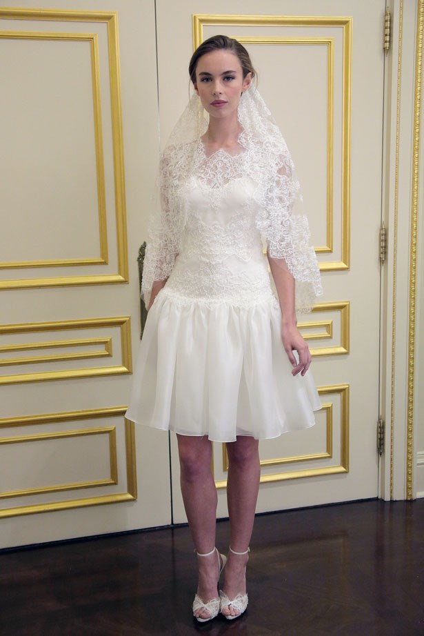 The lace looks demure but the hemline allows for high kicks. <br><br> Marchesa bridal fashion week AW15