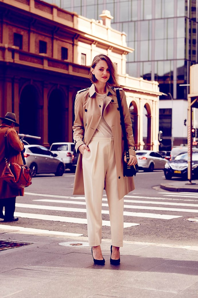 """<strong>DEE JENNER MARKET EDITOR</strong><br> WEARS: <strong>The Kensington </strong><br> (modern fit, tapered waist, slim sleeves)<br><br> """"As the trench is such a classic piece, I've gone with cream on cream to keep the outfit polished but fresh. Linen tees are my new obsession and I think opting for one instead of a button-up shirt makes the traditional trench seem a touch more youthful. Simple black and gold accessories pull it all together.""""<br><br> Trench, $2,495, Burberry, burberry.com; tee, $29.95, trousers, $69.95, both H&M, hm.com/au; heels, $526, Sergio Rossi, stylebop.com; bag, $2,695, Salvatore Ferragamo, 1300 095 224"""