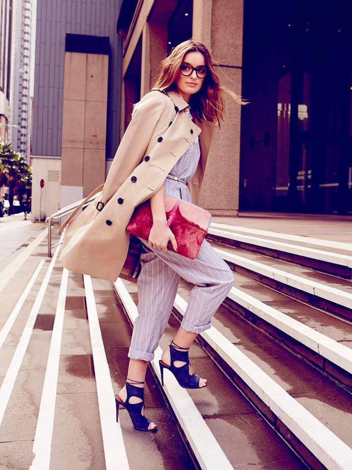 """<strong>CLAUDIA JUKIC FASHION NEWS CONTRIBUTOR</strong><br> WEARS: <strong>The Sandringham</strong> <br>(slim fit, fitted waist, narrow sleeves)<br><br> """"To me, a trench can be a little serious, so I've paired it with a jumpsuit to make it fun. My fave blue suede shoes fall in the same playful category. And this furry clutch adds a little bit of luxe texture – anything pink is okay with me."""" <br><br> Trench, $2,495, Burberry, burberry.com; shirt, $39.90, Uniqlo, uniqlo.com/au; jumpsuit, $269, Lonely Hearts, lonelyheartslabel.com; heels, $588, Aquazurra, matchesfashion.com; Claudia's own glasses; belt, $65, Jigsaw, jigsawclothing.com.au; clutch, $630, Brady Chapman, bradychapman.com.au; ring, $99, Pink LouLou, pinkloulou.com"""