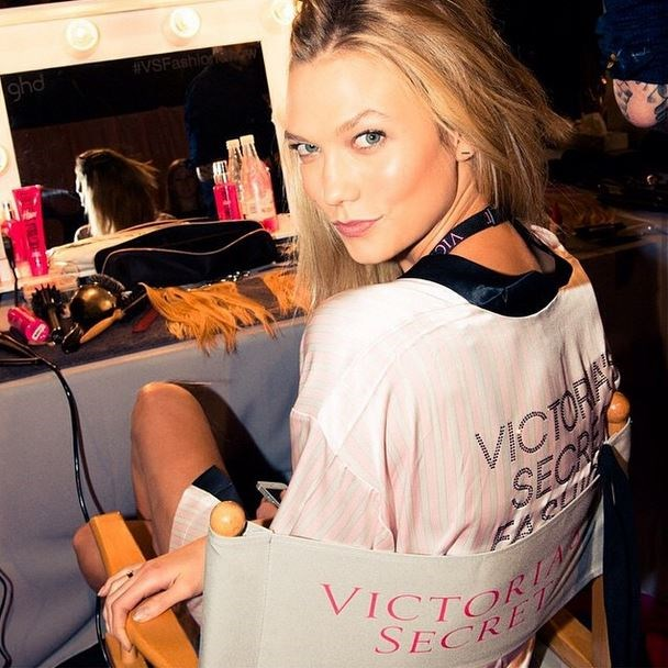Karlie Kloss gets a final touch up before the show.