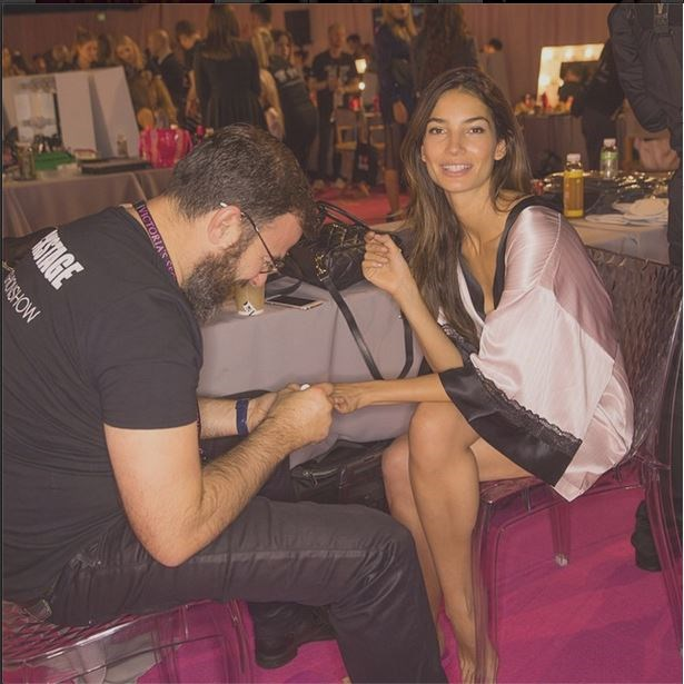 Lily Aldridge gets her nails painted in the VS mani station backstage.