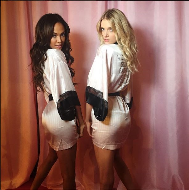 Joan Smalls poses with Lily Donaldson showing off classic bombshell waves.