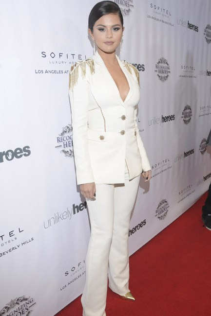 The military-style embellished shoulder-pads <em>maketh</em> Selena Gomez's Versace ensemble and the gold pointed pumps were so on point.
