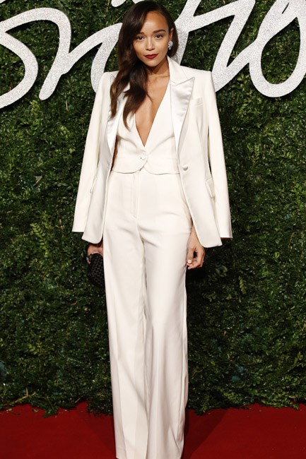 Ashley Madekwe in a Banana Republic high-sheen suit was a decadent take on the seventies uniform. A red lip and plunging neckline ensured that this look was <em>va-va-voom</em>.