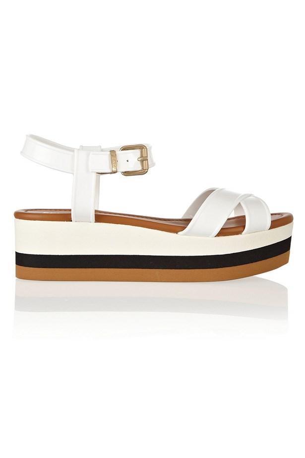 "Flatform, $465, Fendi, <a href=""http://www.net-a-porter.com/product/399879/Fendi/hydra-pvc-wedge-sandals"">net-a-porter.com</a>"