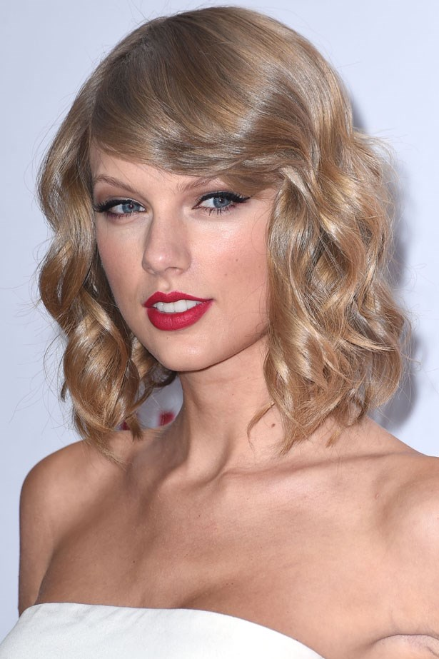 Taylor wore a warm berry toned red lip at an event in Las Vegas earlier this year.