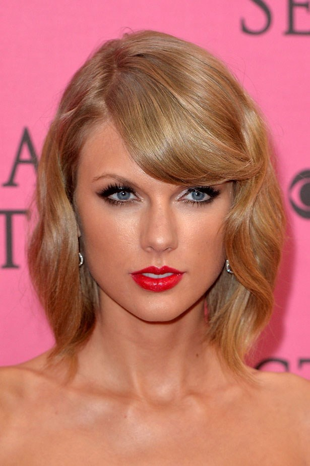 For the 2014 Victoria's Secret Fashion Show earlier this month, Swift went glam with a glossy red lip.