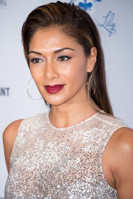 Nicole Scherzinger gave a hint of a quiff with a hefty side of hairspray.