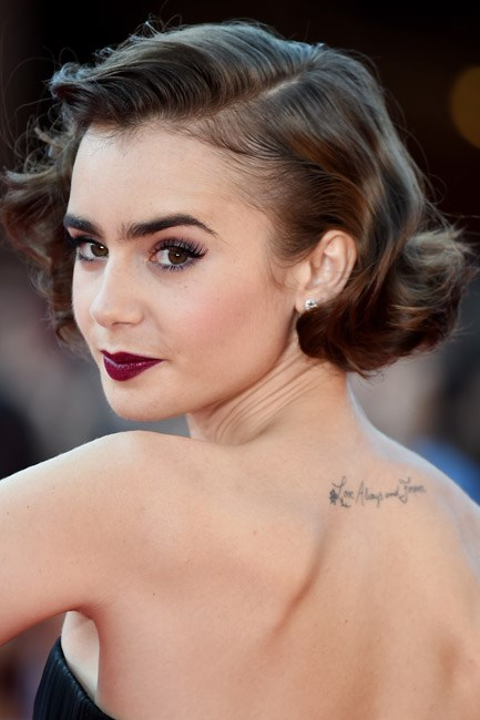 <strong>Brow powder + Eyeshadow + Eyeliner + Lipstick = Lily Collins</strong><br><br> A plumb lip with <em>those</em> brows and <em>that</em> 'do make her a modern-day pinup.