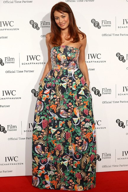 Olga Kurylenko's brightly printed Matthew Williamson gown was taken down a notch (in the best possible way) with the pocket detailing.