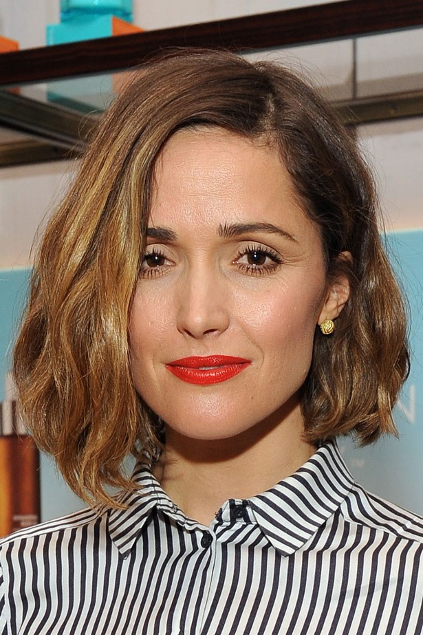 <p>Easily go from work to the party by adding a bold lip and beachy waves.</p> <em>Rose Byrne</em>