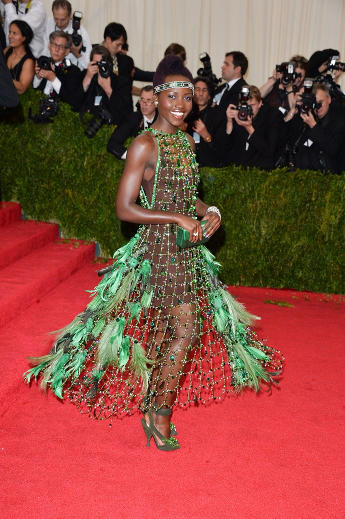 Lupita Nyong'o <br> Wearing: Prada dress <br> Where: Metropolitan Museum of Art's Costume Institute Gala