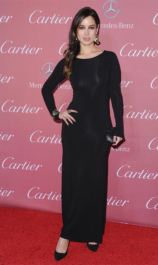 Bond girl Bérénice Marlohe covers up but keeps her curves in slinky black long sleeves