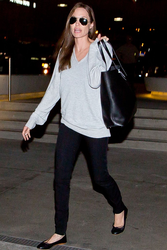 <strong>Angelina Jolie</strong> <br> Ange knows luxe basics (cue a cashmere sweater and leather ballet flats) are the way to go when on-the-go.