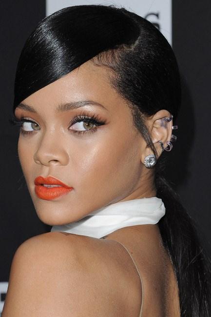Rihanna puckered up to a tangerine shade.