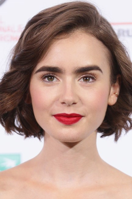 A striking red was the centrepiece of Lily Collins' makeup look.