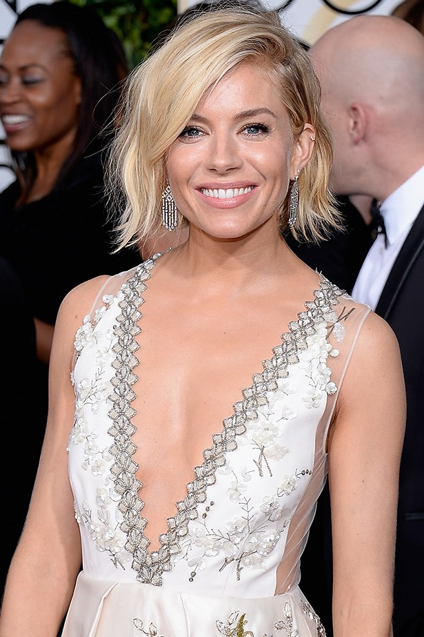 """Sienna Miller <br><br> """"My personal favourite from the 2015 Golden Globes. Perfect length, love the bend in the hair and elegant side part. This shows that this cut is totally cool for a red-carpet event, love it,"""" said Brad Ngata."""