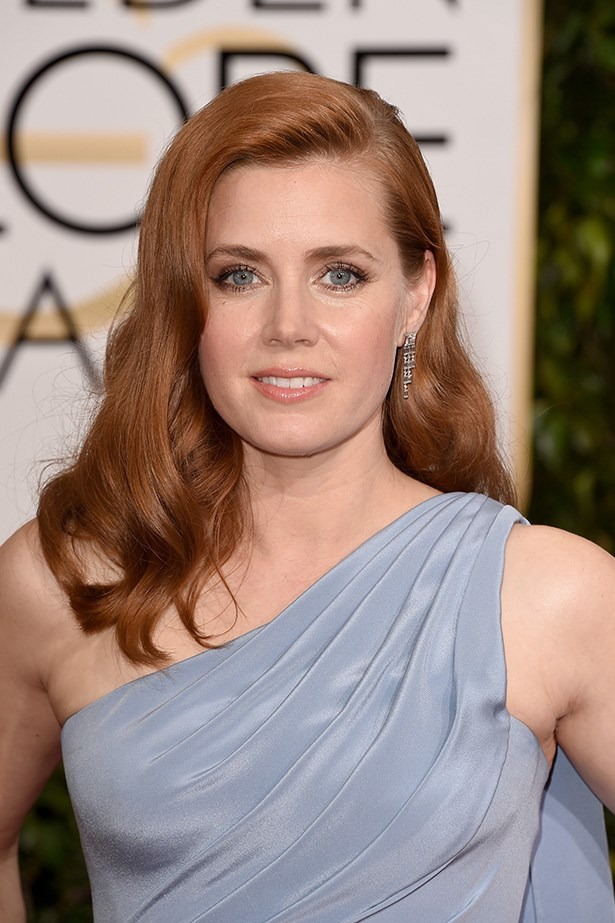 """Amy Adams <br><br> """"Retro relaxed waves , the side part is a big trend and the colour of Amy's hair is beautiful next to her skin,"""" Brad Ngata."""