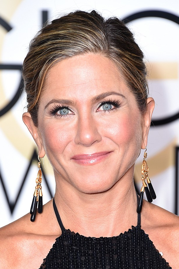 """<strong>Jennifer Aniston </strong> <br><br> """"Loving the loose knot of hair pinned and secured up the back, keeping in with the whole Jennifer vibe of what I love about her. She stays true to her style and never leaves it astray no matter what the fashion trend may be,"""" said Anthony Nader."""