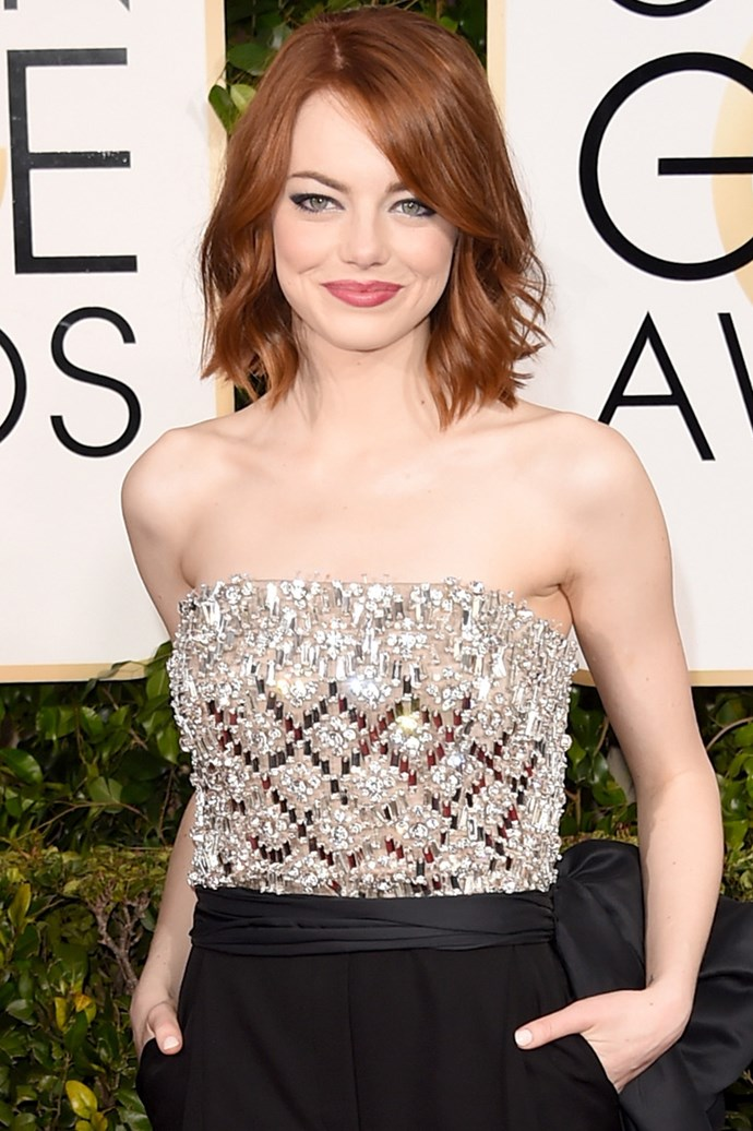 """Emma Stone  <br><br> """"I've died and gone to heaven! Seriously, Emma's haircut and raven red  colour is such a 10 out of 10. The lazy relaxed waves paired up with the bluntest edge bob is a runway hit and a complete winner,"""" Anthony Nader."""