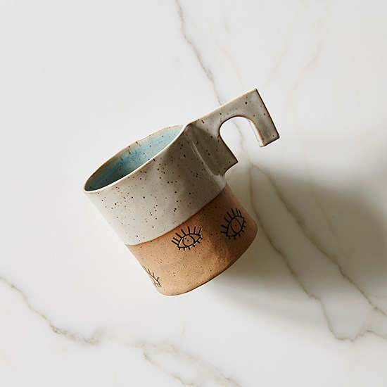 "Perfect for a giant cup of herbal tea. <a href=""http://www.oneofafew.com/product/martina-thornhill-eye-mug-with-handle"">Mug, $48, Martina Thornhill, oneofafew.com</a>"