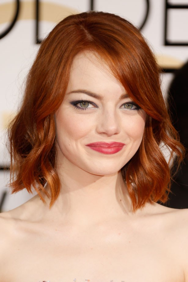 We love the unexpected pairing of a rose lipstick with Emma Stone's red hair.
