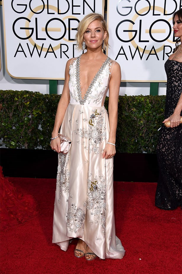 At the 72nd Annual Golden Globe Awards wearing Miu Miu