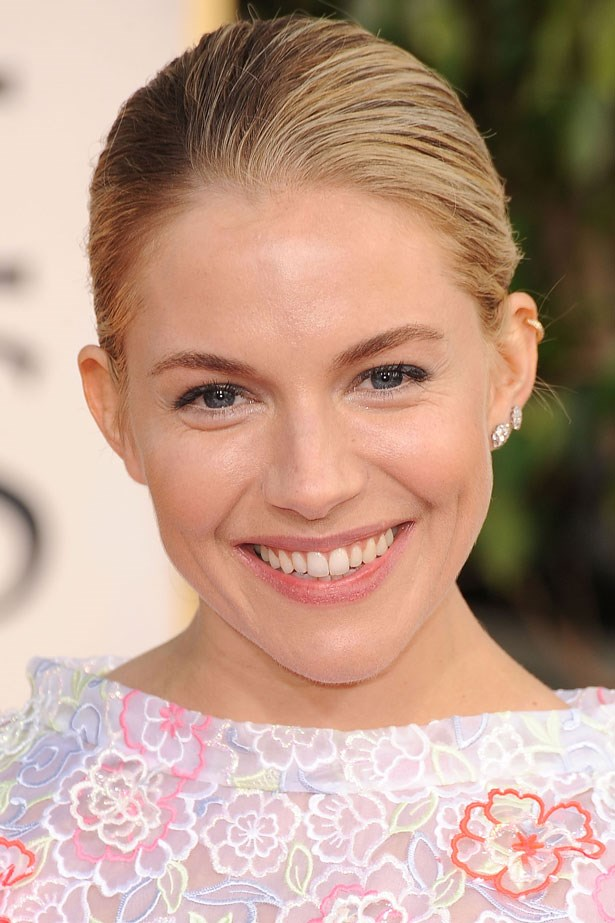 Sienna was photographed at the 70th Annual Golden Globe Awards in 2013 with minimal makeup and a smoothed back bun.
