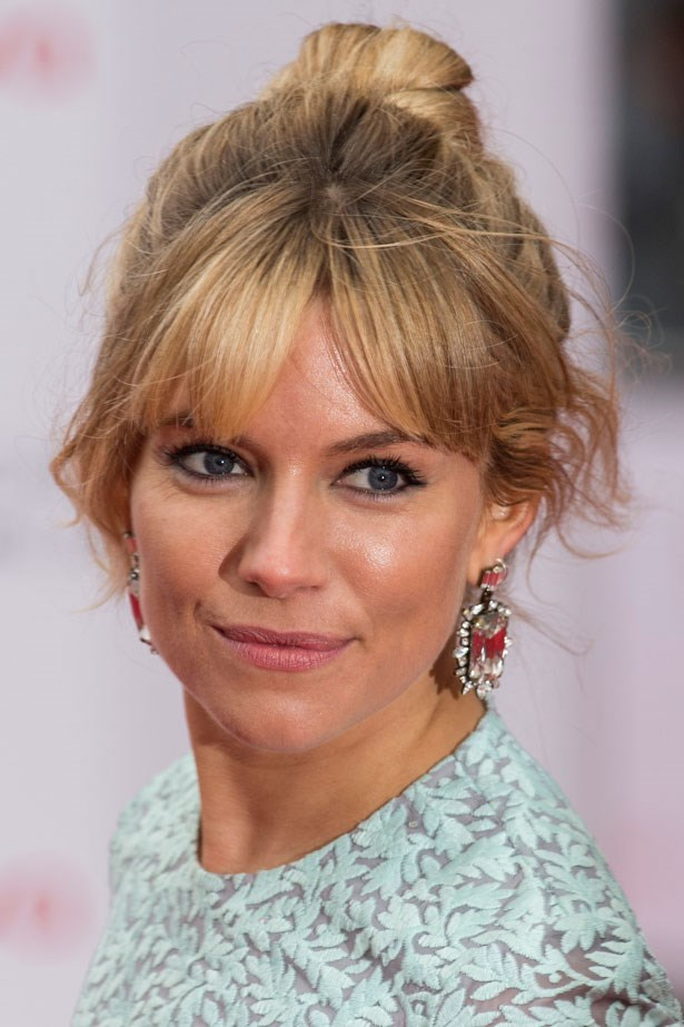 Sienna wore kohl rimmed eyes and a topknot to the British Academy Television Awards in 2013.