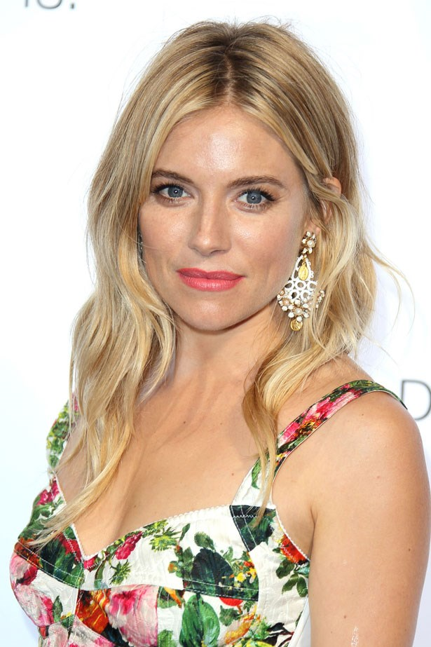 Seen at an event in July 2013, Miller matched the soft pink tones of her lipstick to her dress and had beachy waves.