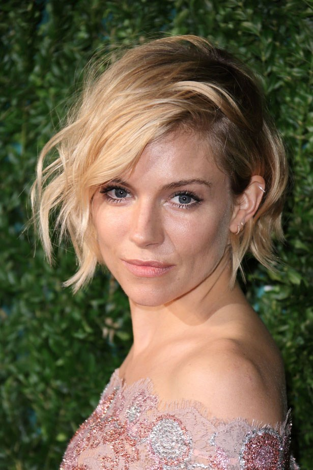 """Sienna's blonde chop and subtle cat eye started massive <a href=""""http://www.elle.com.au/beauty/trends/2015/1/beauty-trends-from-the-73rd-golden-globe-awards-short-hair-and-side-parts/sienna-miller/"""">hair envy</a> in November 2014."""