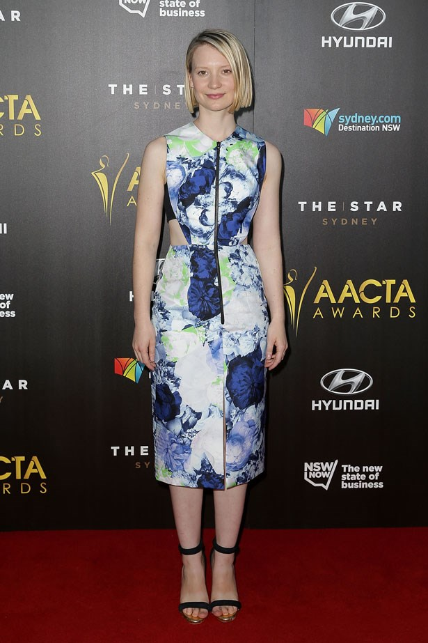 Mia Wasikowska is photographed in a multi-coloured Josh Goot dress.