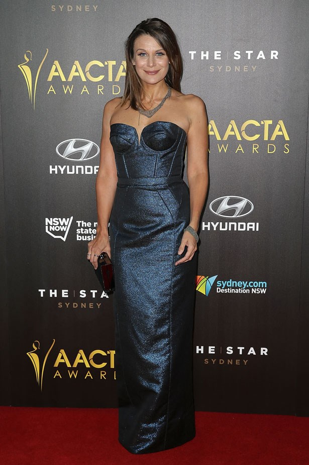Diana Glenn wears a strapless midnight blue gown.