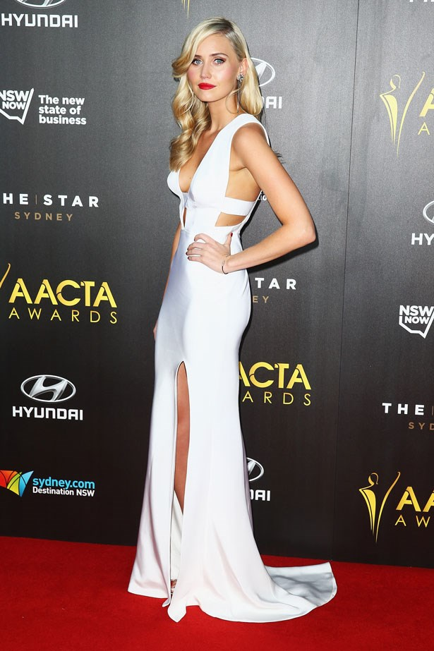 Anna Bamford stunned in a white, cut-out Pallas Couture gown.