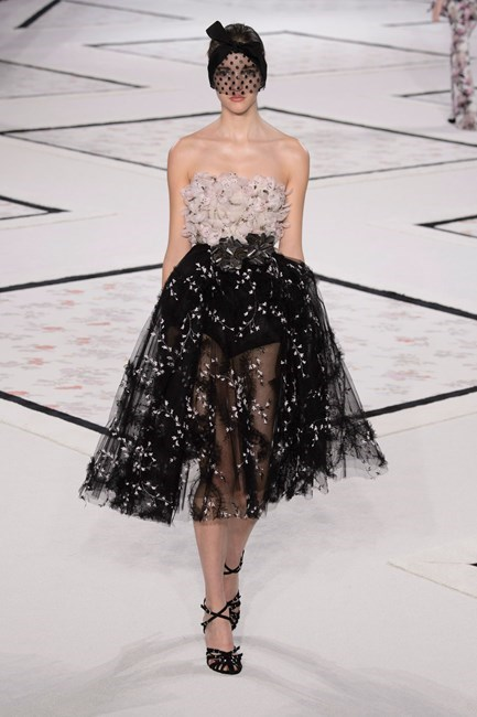 """<strong>Dannielle Cartisano, fashion assistant</strong> <br /> <br /> """"I'm always obsessed with Giambattista Valli couture. The headpiece and dress is beyond amazing and it's all in my perfect colour combination – I love to ground pretty pastels with black. Killer!"""" <em>Giambattista Valli couture, spring 15 </em>"""