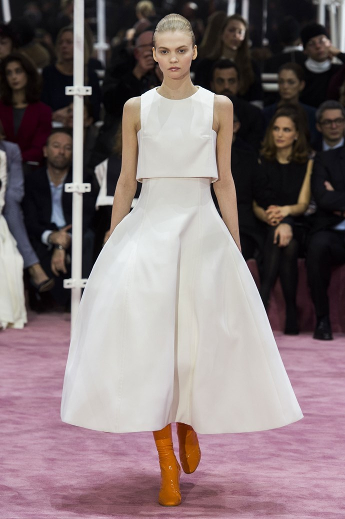 """<strong>Amanda Spackman, digital product manager</strong> <br /> """"If I had to wear one thing for the rest of my life it would be this white two-piece from Dior. A clean-cut crop top with a skirt full of volume, teamed with a sleek 'do', is my idea of a classic. I'll leave the shoes, sorry Raf. It will be pumps all the way."""" <br /> <em>Christian Dior couture, spring 15 </em>"""