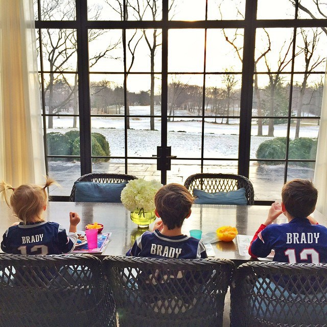 The second photo showed the Brady bunch at breakfast decked out in their Pats gear.