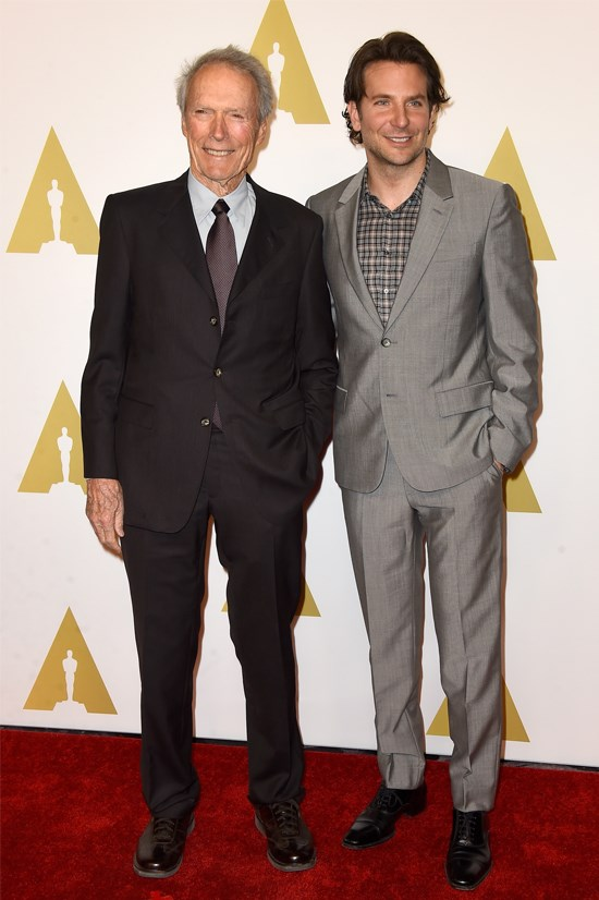 """Bradley Cooper, nominated for best actor in """"American Sniper"""", and director Clint Eastwood."""