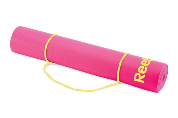 """Slightly thicker than a standard mat, the Premium Yoga Mat was designed with balance in mind. With a non-slip base, and increased floor coverage, this mat is ideal for studio use. <p>  Premium Yoga Mat, $60.40, Reebok, <a href=""""http://www.activinstinct.com/"""">activinstinct.com</a></p>"""