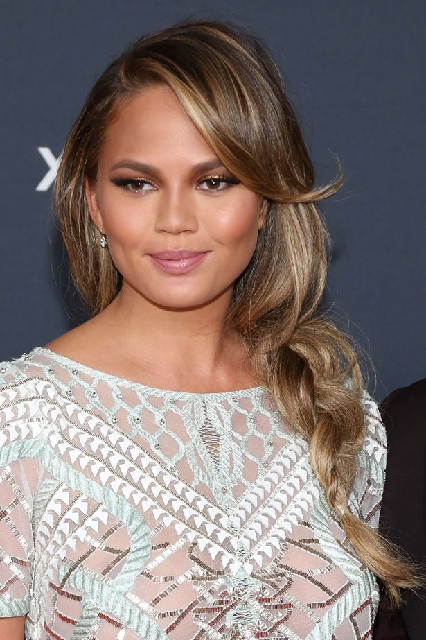 <p><strong>Chrissy Teigen</strong></p> <p>Chrissy Teigen showed up at the 2015 NFL Honours pre–Super Bowl event wearing a loose side swept braid that would work just as well at the game as it would on the red carpet.</p>