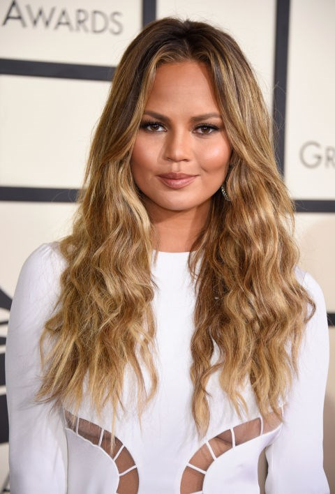 <strong>Chrissy Teigen</strong><br> Chrissy Teigen's skin is glowing against her white dress and those thick beachy waves are pretty much perfect.