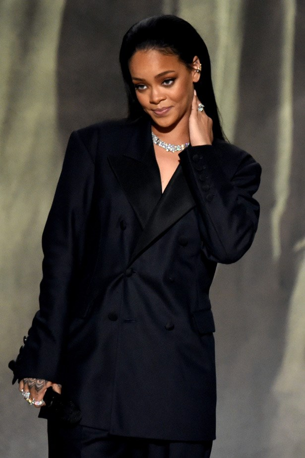 "For her performance with Kanye West and Paul McCartney, Rihanna changed out of her <a href=""http://www.elle.com.au/fashion/celebrity-style/2015/2/best-dressed-at-the-2015-grammys/"">Giambattista Valli Haute Couture gown</a>  and into this simple and clean Martin Margiela suit"