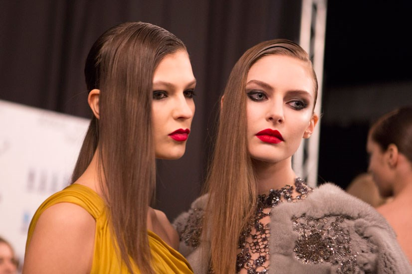 "Monique Lhuillier with hair by Bob Recine for Moroccanoil, created three different looks inspired by the ""edginess and sultriness of the modern woman"" and more specifically Kate Moss. A top knot, asymmetrical ponytail and straight style all complemented the collection."