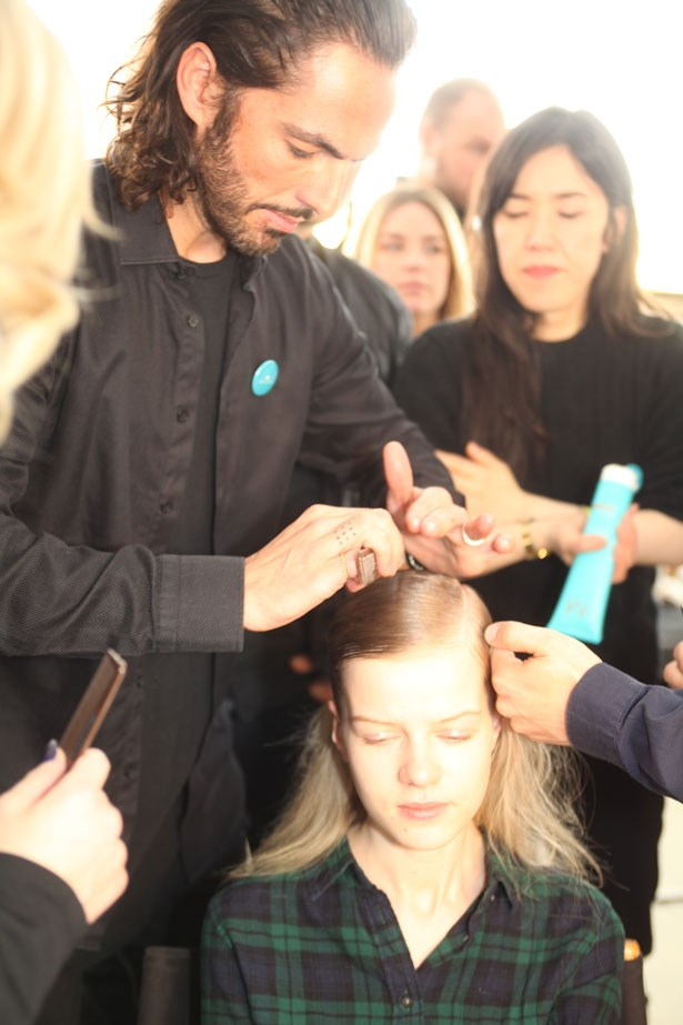 """Cushnie Et Ochs with hair by Moroccanoil's Global Amabassador Antonio Corral Calero, together with designers Carly Cushnie and Michelle Ochs were inspired by the view of earth from outer space for their collection this season. Hair was slicked back and pinned into place, leaving the lengths undone and messy to reflect the """"contrasting textures found in space, the hair style showcases the duality of soft and strong—distinctly different, but undeniably connected""""."""