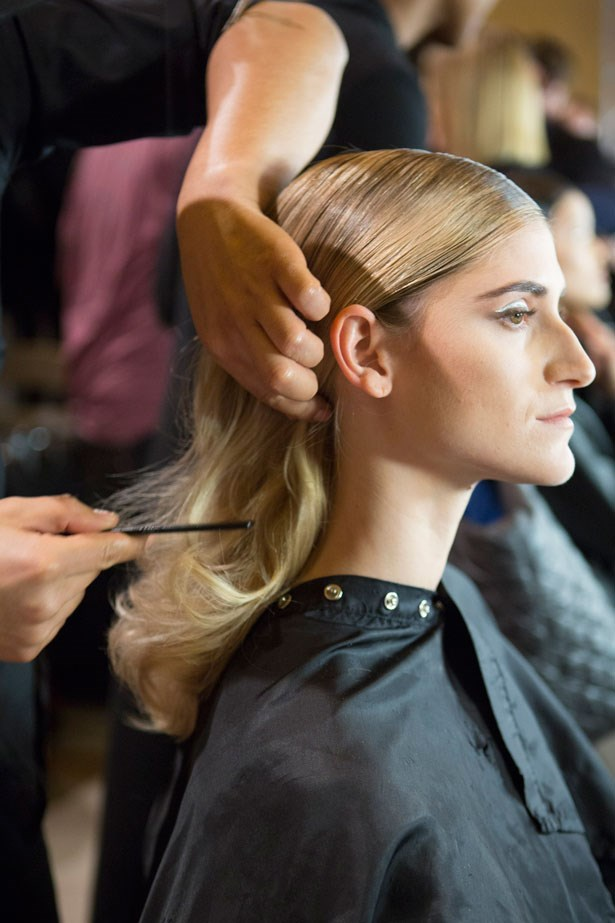 """Zac Posen with hair design by Odile Gilbert for Moroccanoil created a """"controlled glamour"""" style that was modern and masculine in the front and feminine and chic in the back to complement the collection."""